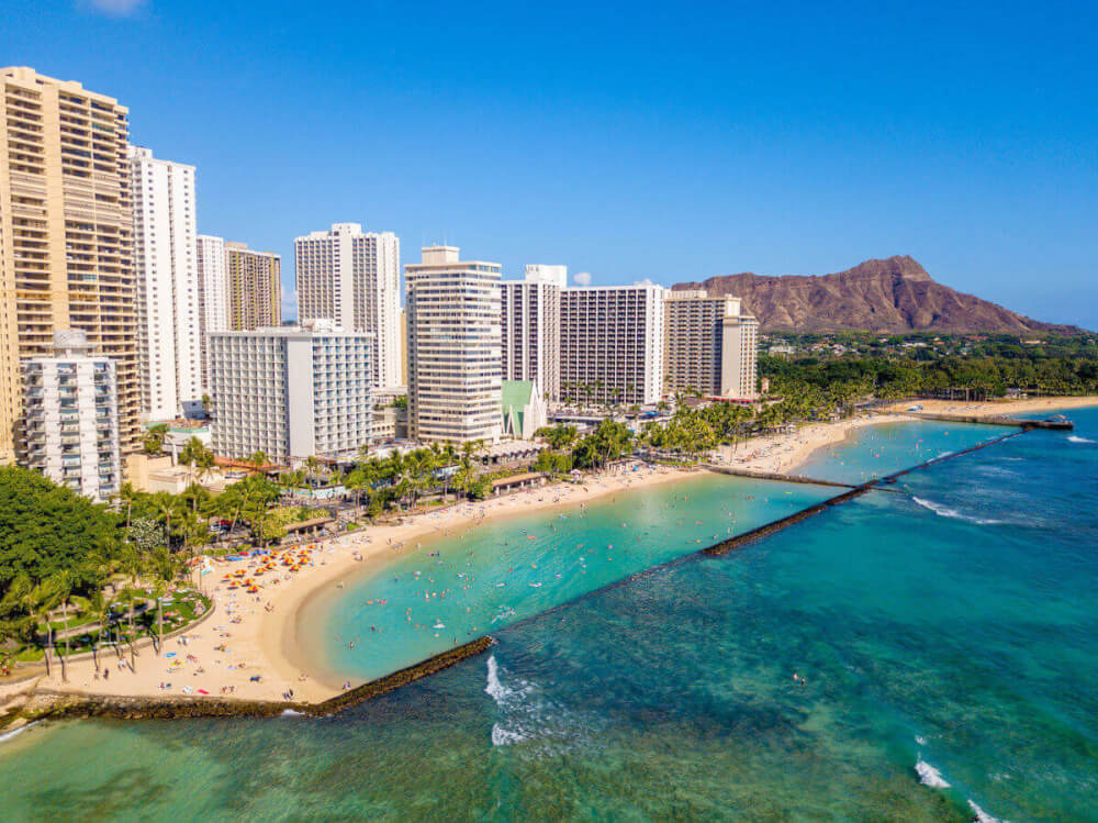 Find out the best places to stay on Oahu recommended by Top Hawaii blog Hawaii Travel with Kids! Image of Waikiki beach with hotels