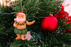 Find out how to create a Hawaii Christmas at home by top Hawaii blog Hawaii Travel with Kids! Image of a hula Santa ornament.