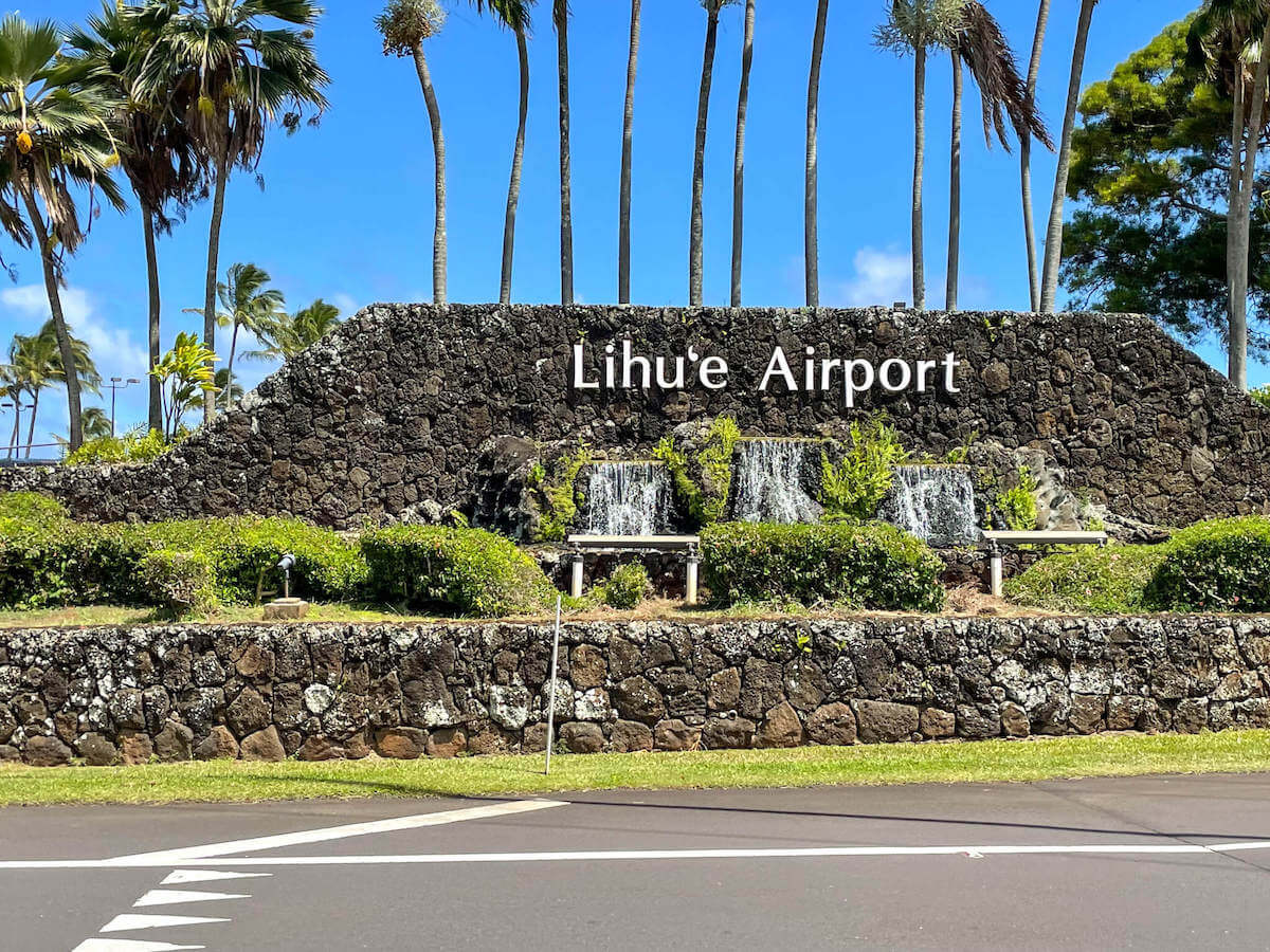 Find out everything you need to know about Lihue Airport on Kauai by top Hawaii blog Hawaii Travel with Kids. Image of the Lihue Airport sign