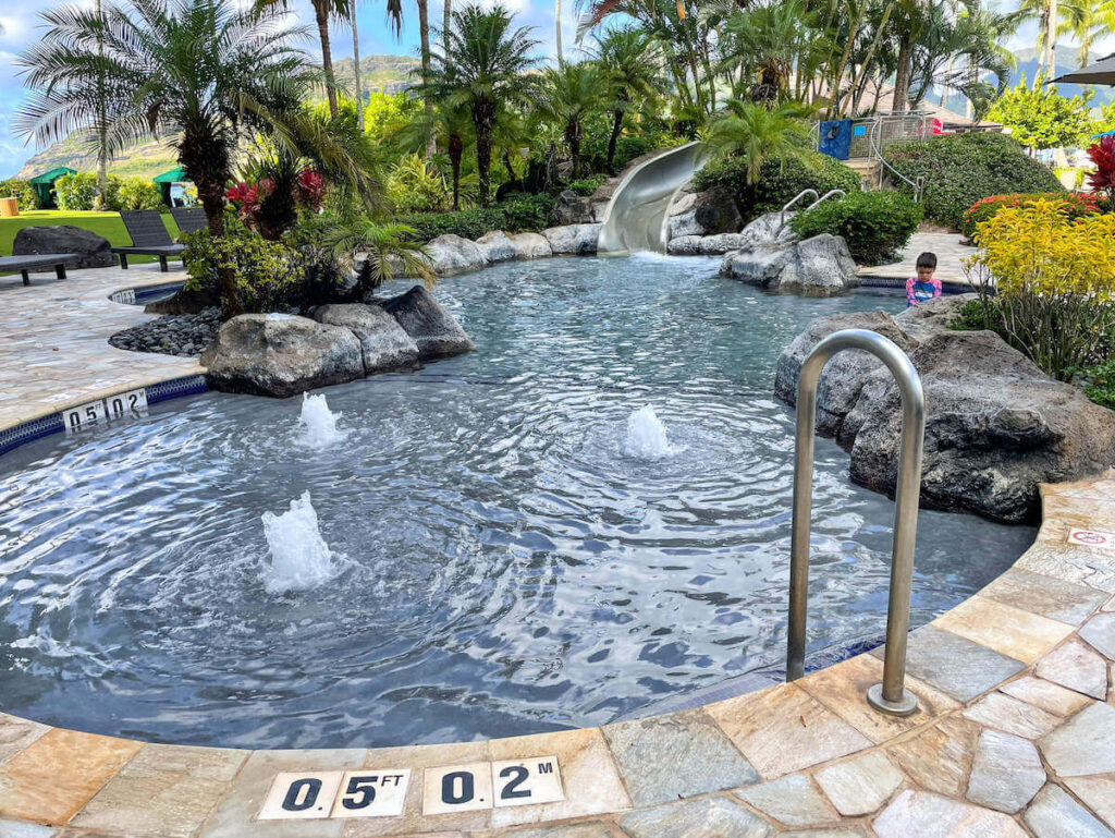 Where to stay on Kauai with kids: Royal Sonesta Kauai review. Image of the kiddie pool and water slide.