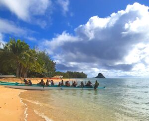 Find out what to do on Secret Island Oahu by top Hawaii blog Hawaii Travel with Kids. Image of a Hawaii beach and canoe