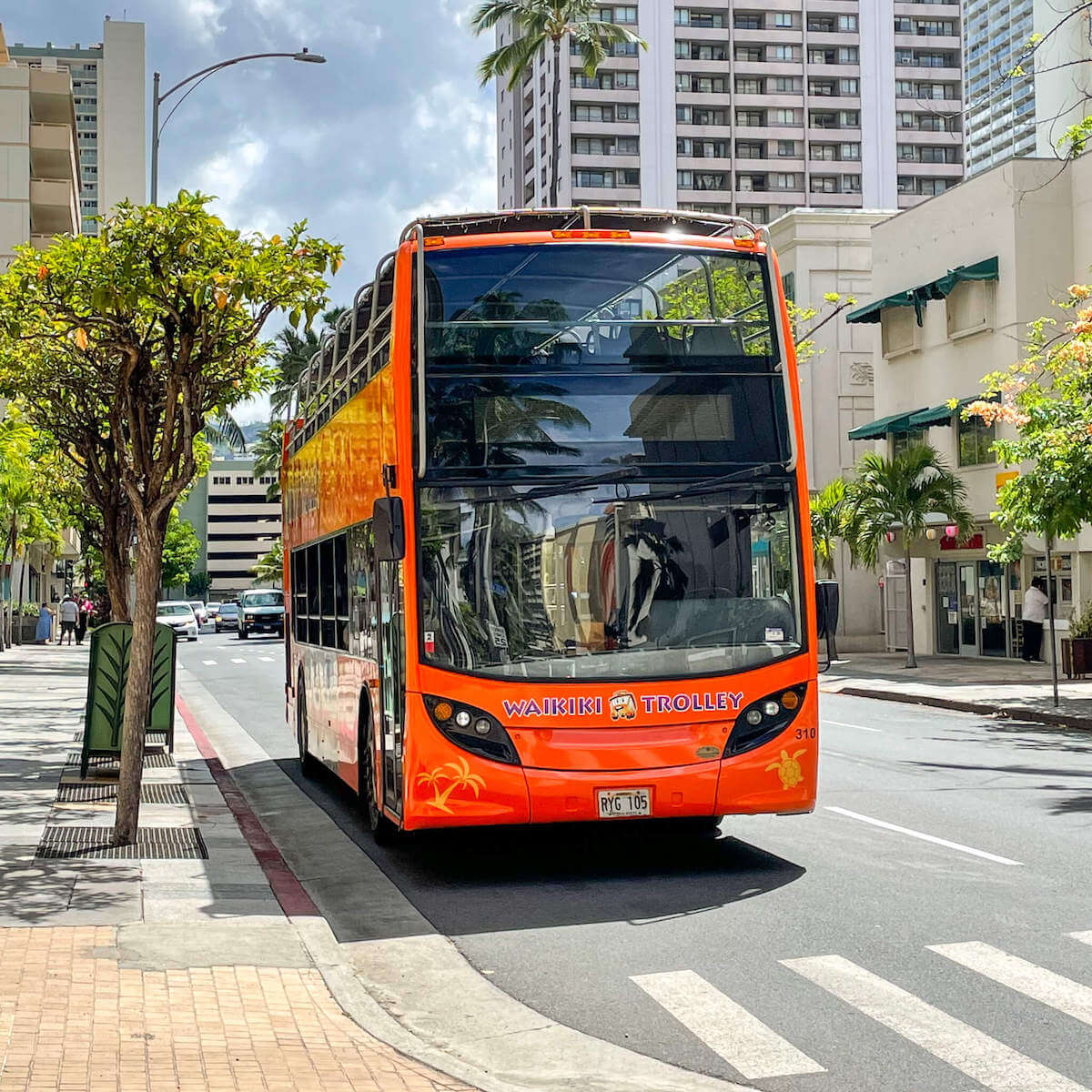 Read this honest Waikiki Trolley review by top Hawaii blog Hawaii Travel with Kids. Image of a red trolley in Waikiki.