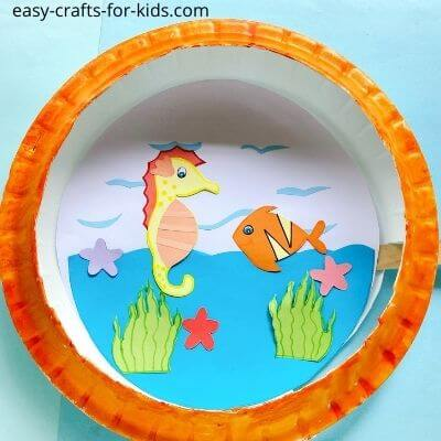 This fish and seahorse paper plate craft is a fun ocean craft for preschoolers.